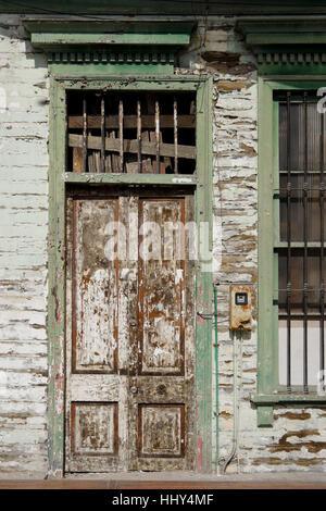 Door of building in disrepair, Iquique, Chile - Stock Photo