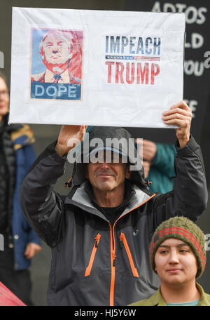 Sacramento, USA. 20th Jan, 2017. A large angry protest against the inauguration of President Donald Trump marched - Stock Photo