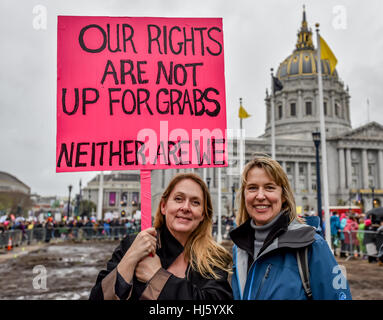 San Francisco, California, USA. 21st January, 2017. Two women hold sign in front of San Francisco Cit Hall that, - Stock Photo