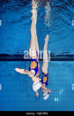 Underwater view of Synchronized Swimming, Nikolaev, Ukraine, Eastern Europe - Stock Photo
