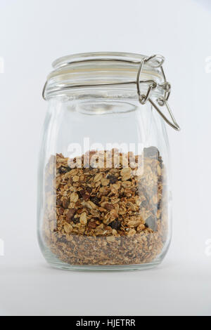 Home made granola in a glass jar - Stock Photo