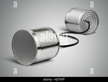 Tin can telephone with cord on grey, telephony concept - Stock Photo