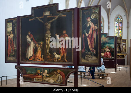 Visitors in front of the Isenheim Altarpiece (1512–1516) by German Renaissance painter Matthias Grunewald displayed - Stock Photo