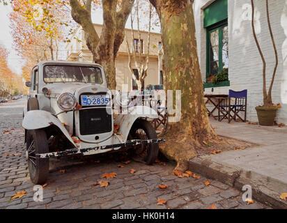 Vintage car on a cobblestone lane of the historic quarter, Colonia del Sacramento, Colonia Department, Uruguay, - Stock Photo