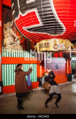 women taking photo of Kaminari-mon gate, in Senso-ji Temple, Asakusa,Tokyo, Japan - Stock Photo