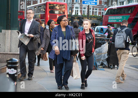 LONDON, ENGLAND - JULY 12, 2016 People after work to go around Liverpool Street station - Stock Photo