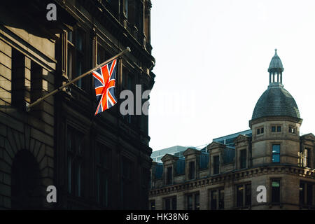 Close up of a Manchester street with the Union Jack light by the sun - Stock Photo