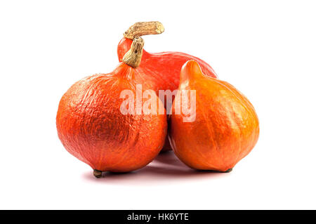 Three Red pumpkins isolated on white - Stock Photo