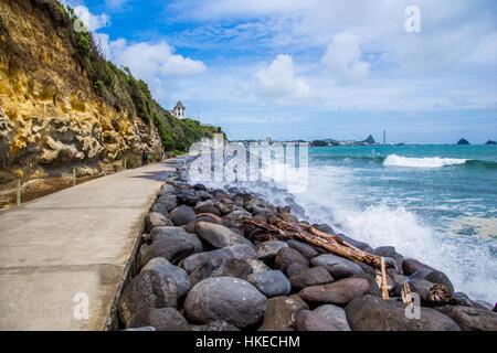 Taking a stroll along the New Plymouth Coastal Walkway - Stock Photo