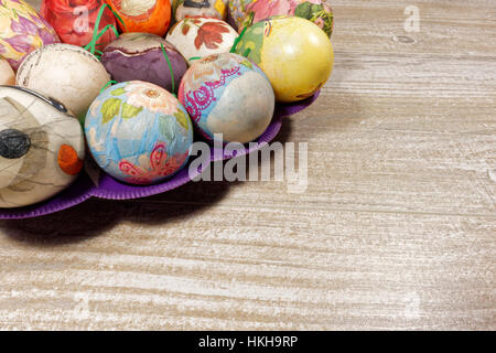 Decoupage decorated colorful Easter eggs - Stock Photo