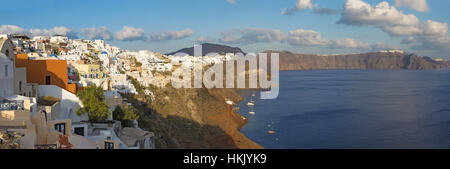 SANTORINI, GREECE - OCTOBER 5, 2015: The look from Oia to east in evening light. - Stock Photo
