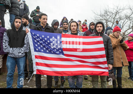 Hamtramck, USA. 29th January, 2017. Hundreds, including these young immigrants from Yemen, rallied at Hamtramck - Stock Photo