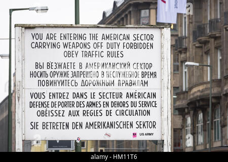 A sign advising people that they are entering the American Sector can still be seen at the site of checkpoint charlie - Stock Photo