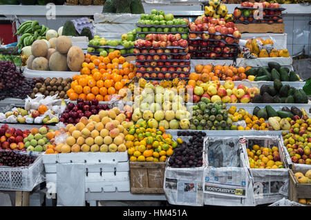 Colorful fruit stand with exotic fruits on display, Inaquito Market food court, Quito, Ecuador - Stock Photo