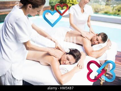 Composite image of couple receiving massage at spa - Stock Photo