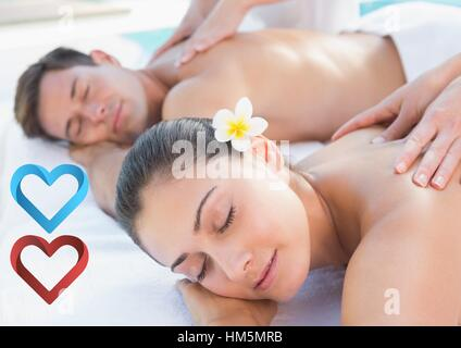 Couple receiving massage in spa - Stock Photo