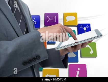 Businessman using tablet against applications icons - Stock Photo