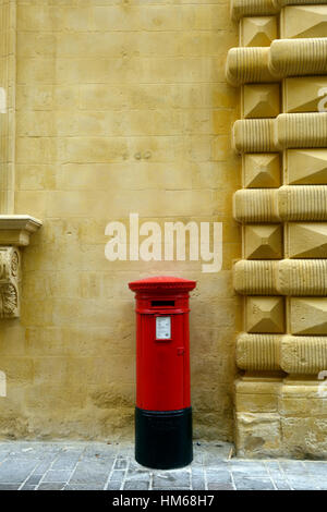 red letter box Valletta Malta traditional pillar style english british rule throwback traditional postal system - Stock Photo