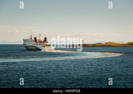 MV Loch Seaforth sailing from Stornoway to Ullapool past Arnish Lighthouse in the Isle of Lewis, Outer Hebrides, - Stock Photo