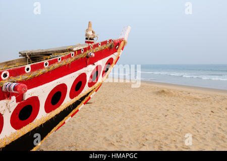 Fishermen boat on the sandy beach in Orissa, India - Stock Photo