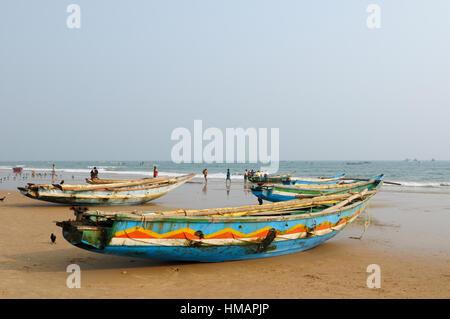 Fishermen boat on a sandy beach in Orissa, India - Stock Photo