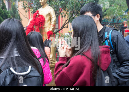 a golden sacred statue in Sik Sik Yuen Wong Tai Sin temple in Hong Kong - Stock Photo