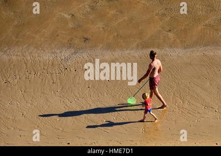 family vacationing, free of crowd Porto de Mos beach, Lagos, Algarve, Portugal, Europe - Stock Photo