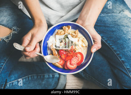 Yogurt, granola, seeds, fresh, dry fruits and honey in bowl - Stock Photo