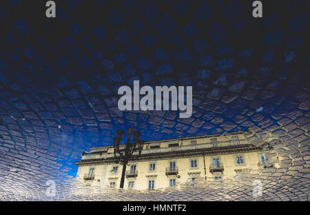 reflection on the puddle in the city - Stock Photo