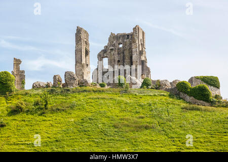 View of the the hilltop ruins of Corfe Castle, survivor of the English Civil War, in Corfe, Dorset, south-west England - Stock Photo