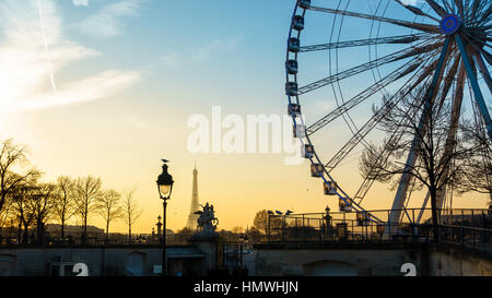 The ferris wheel and the Eiffel Tower in Paris, France - Stock Photo