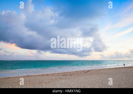 Atlantic ocean coast. Landscape with dramatic cloudy sky in sunrise, Dominican republic. Punta Cana. Bavaro beach - Stock Photo