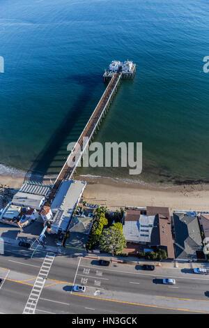 Malibu, California, USA - December 17, 2016:  Aerial of popular Malibu Pier State Park in the Santa Monica Bay. - Stock Photo