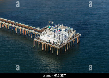 Malibu, California, USA - December 17, 2016:  Aerial of historic Malibu Pier in the Santa Monica Bay. - Stock Photo