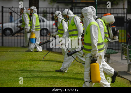 Buenos Aires, Argentina - March 3, 2016: Employees of the Ministry of Environment and Public Space fumigate for - Stock Photo