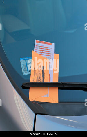 Parking ticket on a car windscreen in the Beacon Hill area of Boston, Massachusetts, United States. - Stock Photo