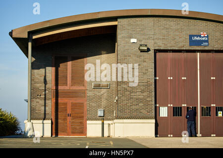 Holyoke Beach landmark RNLI Royal National Lifeboat Institution is the charity that saves lives at sea Wallasey, - Stock Photo