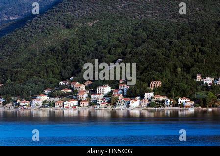 Waterfront village along the Bay of Kotor, Montenegro - Stock Photo