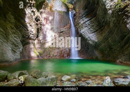 Kozjak waterfalls to the beautiful cave of Triglav National Park in Slovenia - Stock Photo