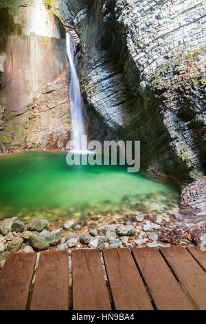 Kozjak waterfalls to the beautiful cave of Triglav National Park in Slovenia - Stock Photo