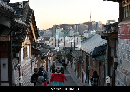 Bukchon Hanok Village, a Korean traditional village in Seoul, South Korea, Asia. Tourists and people visiting the - Stock Photo