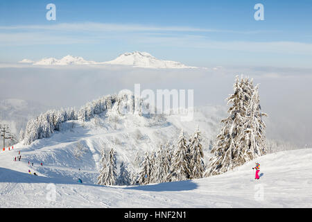 MORZINE, FRANCE - FEBRUARY 06, 2015: Skiers and snow boarders on Le Ranfoilly mountain peak in Les Gets ski resort - Stock Photo