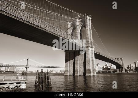 Brooklyn bridge at waterfront in downtown Manhattan New York City. - Stock Photo