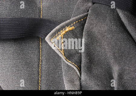closeup of buckles, clasps, zippers, pockets, fasteners, fittings and seams in the brown backpack - Stock Photo