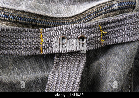 closeup of buckles, clasps, zippers, pockets, fasteners, fittings and seams in the green backpack - Stock Photo