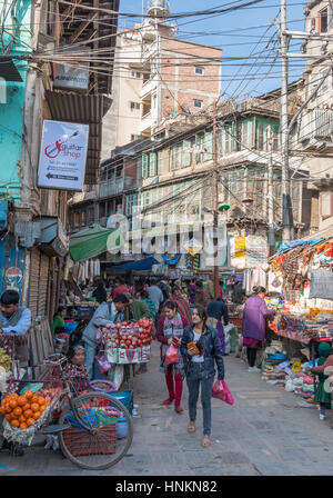 Shop keeps and crowds in the streets of Kathmandu, Nepal - Stock Photo