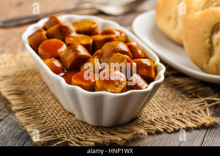german currywurst - pieces of curried sausage - Stock Photo