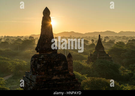 Sunrise over the temples and pagodas in the plain of Bagan, Myanmar - Stock Photo