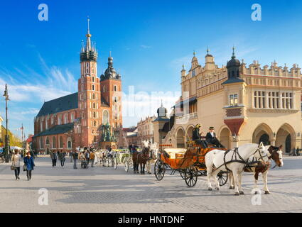 Cracow - Carriage waiting for tourists, St Mary's Church in the background, Poland - Stock Photo