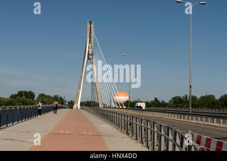Most Świętokrzyski. ( Świętokrzyski Bridge- Holy Cross Bridge) spanning  the Vistula river in Warsaw, Poland. It - Stock Photo